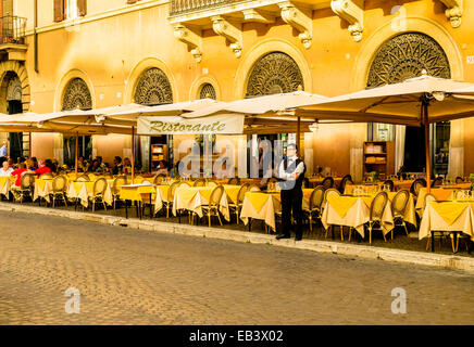 Outdoor restaurant in Piazza Navona, one the largest public square in Rome, Italy - Stock Photo