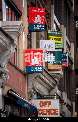 For Sale signs of various real estate agents in City Road, London - Stock Photo
