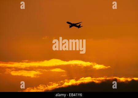Passenger jet at sunset, Honolulu, Oahu, Hawaii, USA - Stock Photo
