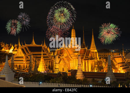 Grand palace and Wat phra keaw in night with new year fireworks - Stock Photo