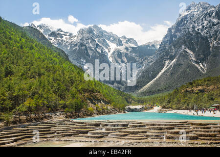 White Water River waterfall and Jade Dragon Snow Mountain, Lijiang, Yunnan China. - Stock Photo