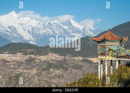 Tibet pavilion and Meili Snow Mountain in Yunnan - Stock Photo