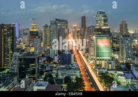 Bangkok Cityscape at twilight with main traffic - Stock Photo