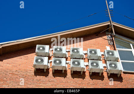 air conditioning equipment on red brick house wall - Stock Photo