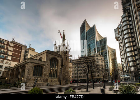 St Andrew Undershaft Church on St Mary Axe with the Willis Building and Lloyd's of London in the City of London - Stock Photo