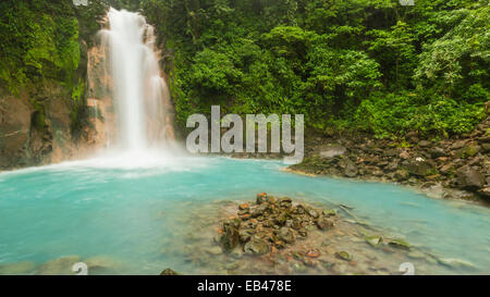 Panoramic image of the cerulean blue waters of the Rio Celeste Waterfall in Volcan Tenorio National Park, Costa - Stock Photo