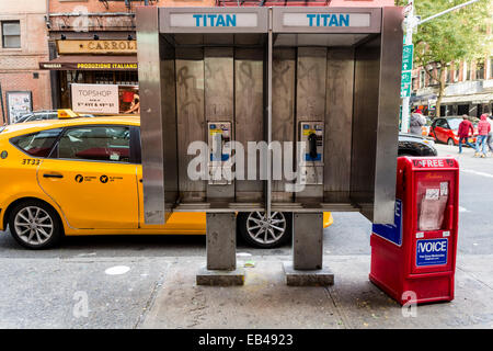 New York, NY 23 Nov 2014 - Public coin-operated pay phone booth - Stock Photo