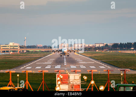 Jet plane taking off from the runway of City Airport, London - Stock Photo