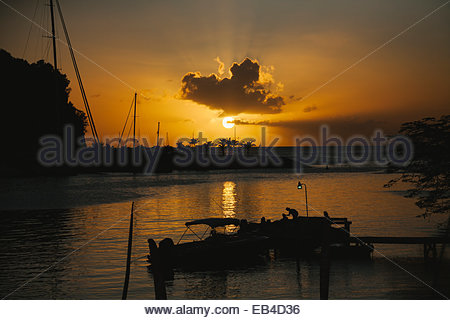 Sunset over Saint George's harbor, the capital city of Grenada. - Stock Photo