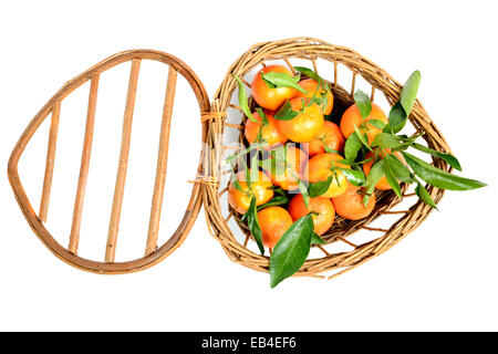 small basket full of mandarin oranges on white background - Stock Photo