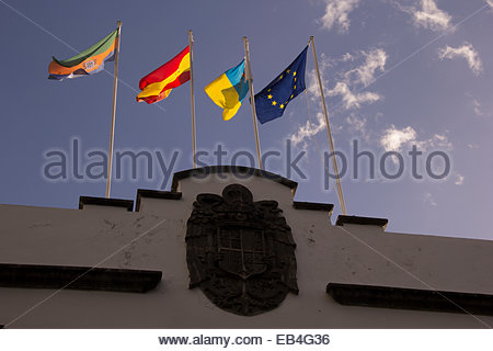 The national flag of Spain, and the flags of the Canary Islands. - Stock Photo
