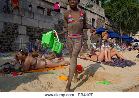 A girl plays at Paris Plage, an artificial, temporary beach on the bank of the Seine River. - Stock Photo