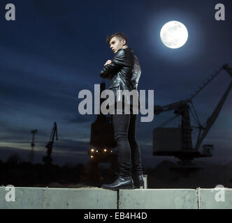 Handsome young man over the building background - Stock Photo