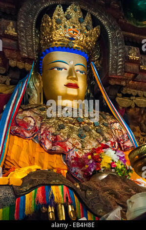 Maitreya Buddha statue inside the Kumbum Chorten at Palkhor Chode Monastery in Gyantse, Tibet, China - Stock Photo