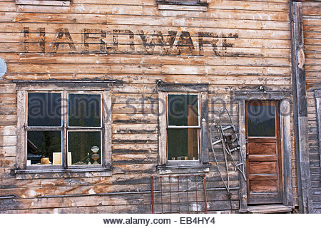 A scenic view of the facade of an old hardware store. - Stock Photo