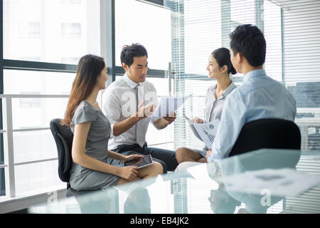 Young business people talking in meeting - Stock Photo