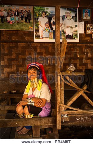 A Karenni woman in front of some pictures sent by relatives who emigrated to the United States. - Stock Photo
