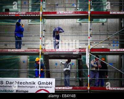 Construction workers on metal Scaffolding building - Stock Photo