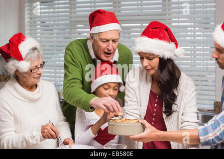Multi-generation family baking together - Stock Photo