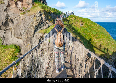 Belfast, Northern Ireland - Aug 19, 2014: People crossing the Rope Bridge: Carrick a rede in North Antrim, Northern - Stock Photo
