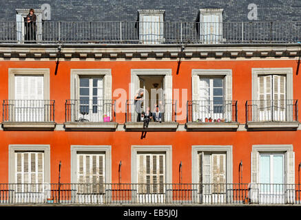 Madrid, Spain. Plaza Mayor. Young people on the balconies of the apartments around the main square. - Stock Photo