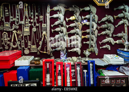Khanjar and  jewelries in a shop at the Souq Muttrah, Muscat, Oman. - Stock Photo