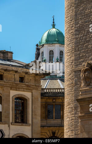 View across Broad Street to the cupola of the Sheldonian Theatre framed between the Clarendon Building and the New - Stock Photo