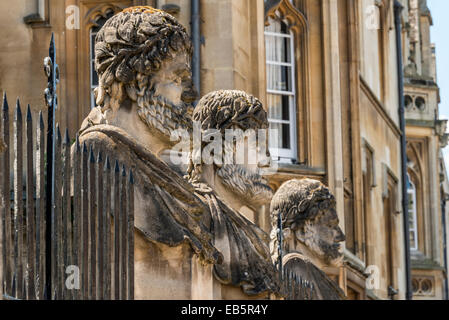 Grotesque decorative stone figure heads outside the Sheldonian Theatre, Oxford University - Stock Photo