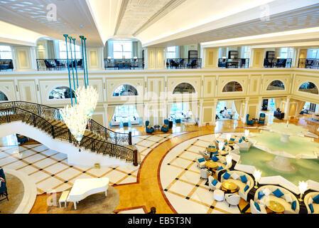 Lobby interior of the luxury hotel in night illumination, Ras Al Khaimah, UAE - Stock Photo