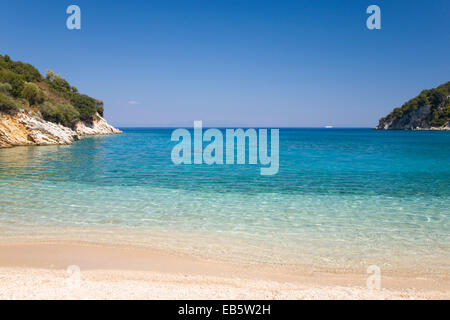 Vathy, Ithaca, Ionian Islands, Greece. View from beach across the clear turquoise waters of Filiatro Bay. - Stock Photo