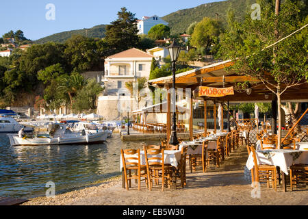 Kioni, Ithaca, Ionian Islands, Greece. View along the waterfront from typical harbourside taverna. - Stock Photo