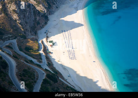 Divarata, Kefalonia, Ionian Islands, Greece. Bird's eye view of Myrtos Beach and its spectacular switchback approach - Stock Photo