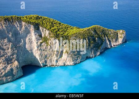 Anafonitria, Zakynthos, Ionian Islands, Greece. View from clifftop to rugged headland above Navagio Bay. - Stock Photo