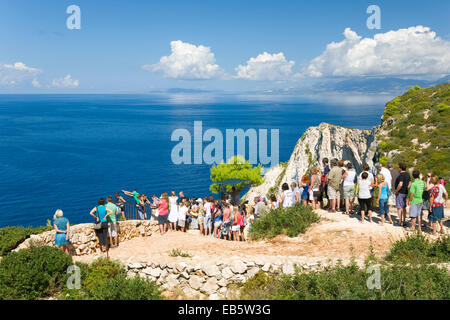 Anafonitria, Zakynthos, Ionian Islands, Greece. Coach party of tourists queuing to see clifftop view over Navagio - Stock Photo