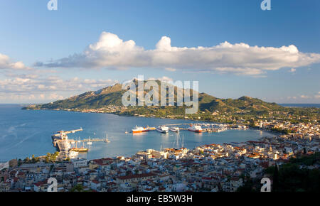 Zakynthos Town, Zakynthos, Ionian Islands, Greece. View from Bochali over city rooftops to the harbour and Vasilikos - Stock Photo