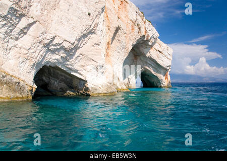 Korithi, Zakynthos, Ionian Islands, Greece. Limestone arches forming openings to the Blue Caves at Cape Skinari. - Stock Photo