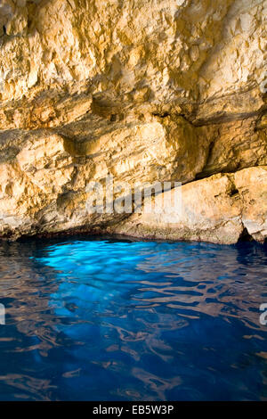 Korithi, Zakynthos, Ionian Islands, Greece. Brilliant blue water inside one of the Blue Caves at Cape Skinari. - Stock Photo