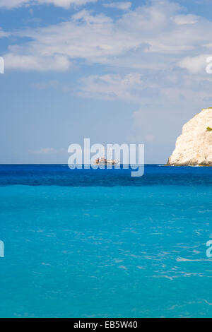 Anafonitria, Zakynthos, Ionian Islands, Greece. View across the turquoise waters of Navagio Bay, sightseeing boat - Stock Photo