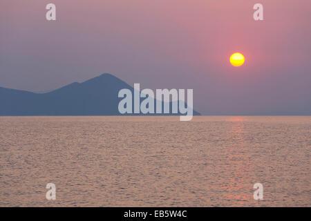 Frikes, Ithaca, Ionian Islands, Greece. View across Frikes Bay to the mountainous island of Atokos, sunrise. - Stock Photo