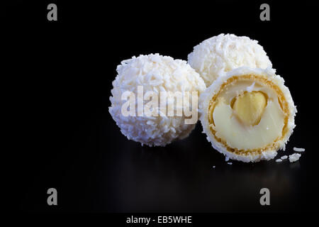 White Chocolate and Coconut Truffles on black background - Stock Photo