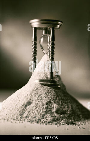 Vintage photo of hourglass, symbolically showing the passing of time - Stock Photo