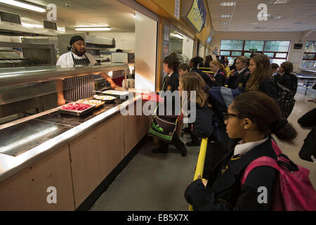 Pupils from Loreto High School in Chorlton, south Manchester, lining up to be served a school dinner by top chef - Stock Photo