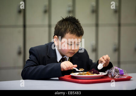 A pupil at Loreto High School in Chorlton, south Manchester eating school dinners cooked by top chefs. - Stock Photo