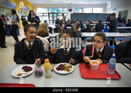 Pupils at Loreto High School in Chorlton, south Manchester eating school dinners cooked by top chefs. - Stock Photo