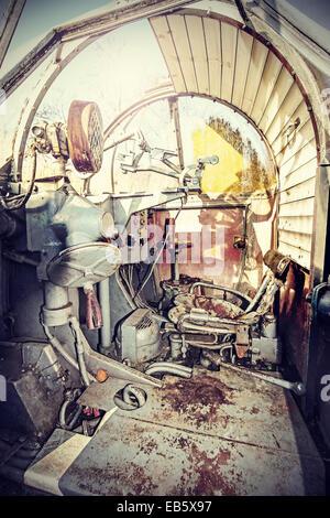Retro filtered picture of machine gun cockpit. - Stock Photo