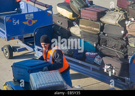 Detroit, Michigan - A baggage handler loads luggage onto a Southwest Airlines plane at Detroit Metro Airport. - Stock Photo