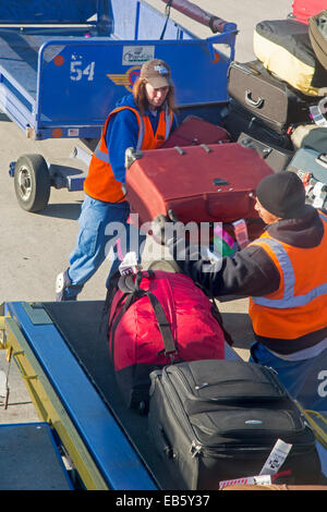 Detroit, Michigan - Baggage handlers load luggage onto a Southwest Airlines plane at Detroit Metro Airport. - Stock Photo