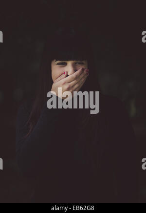 a dark session in a forest - Stock Photo