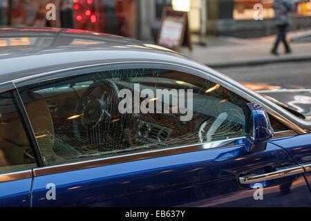 London, UK. 24th November, 2014. A man is arrested for attempting to steal from a Rolls-Royce car in broad daylight. - Stock Photo