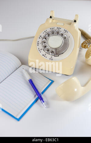 Old fashioned rotary dial telephone. - Stock Photo